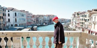 Europe restrictions beginning to be lifted man mask venice